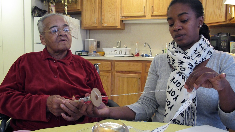 Lois Jones spins her yarn with help from her granddaughter Dhonyale